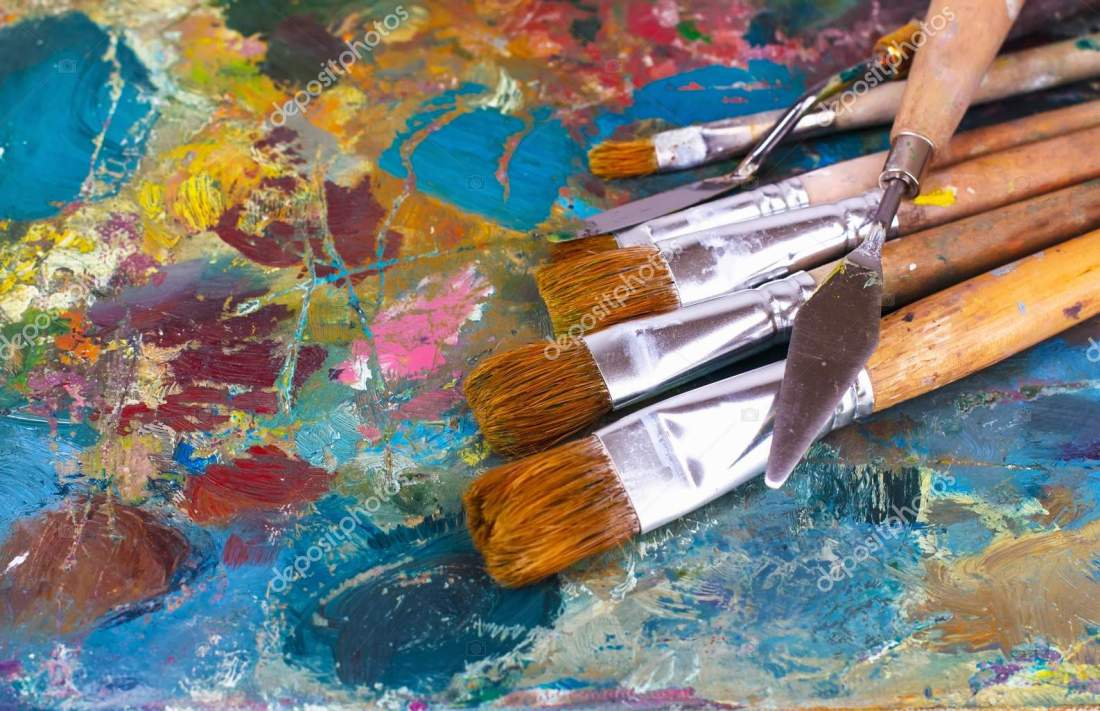 artist's palette with oil paints and brushes